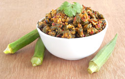 Okra Curry. In a bowl on a wooden background Stock Images