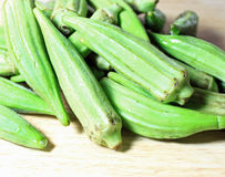 Okra on Cutting Board Stock Images