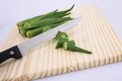 Okra with knife Stock Photo