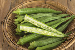 Okra, Lady's Finger. Bhindi and Bamies, Vegetables and herbs in Basket royalty free stock photo