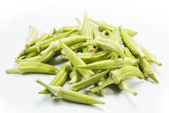 Okra. Or okro known in many English-speaking countries as ladies& x27; fingers, ochro or gumbo, is a flowering plant in the mallow family Royalty Free Stock Photography