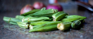 Okra with onions in the background. A vegetable used in making african soup Stock Images