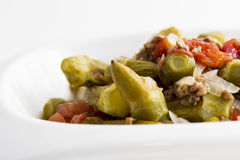Okra. A okra salad with onions, tomatoes and minced meat. Served on white plate Stock Photography
