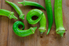 Okra. In table wood arrange Stock Photos