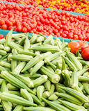 Okra and tomatoes. Okra and cherry tomatoes in bins at the Clement Street Farmers Market in San Francisco royalty free stock photos