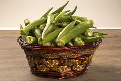 Okra on wooden background Royalty Free Stock Photography