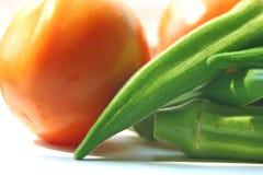 Okra y tomates Fotografía de archivo