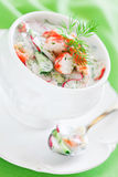 Okroshka. Cold crab soup with cucumber, radishes and kefir, selective focus Stock Photos
