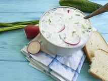 Okroshka on blue wooden bread food summer. Okroshka on blue wooden spoon bread food summer Stock Image