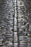 Okrzesana powierzchnia kamienista średniowieczna ulica Obrazy Stock