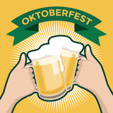 Oktober Beer Festival with two hands toasting glasses of beer Stock Photo