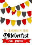 Oktoberfest background for beer festival and travelling funfair. Red ribbon with text welcome. Bunting decoration in Royalty Free Stock Photo