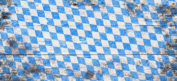 Oktoberfest background with blue and white rhombus pattern. Wooden background. Studio shot Royalty Free Stock Images