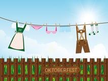 Oktoberfest background, dirndl, lederhosen, panties, lingerie on clothes line Royalty Free Stock Images