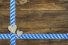 Oktoberfest background with hearts and bavarian ribbon Royalty Free Stock Images