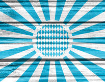Oktoberfest background pattern. Oktoberfest bavarian traditional blue and rhombus background pattern. Blue radial sun rays. Wood texture Royalty Free Stock Images