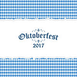 Oktoberfest 2017 background with ripped paper. Oktoberfest background with ripped open paper having blue-white checkered pattern and text Oktoberfest 2017 Stock Images