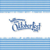 Oktoberfest 2017 background with ripped paper. Oktoberfest background with ripped open paper having blue-white checkered pattern and text Oktoberfest 2017 Royalty Free Stock Photo