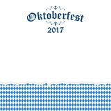 Oktoberfest 2017 background with ripped paper. Oktoberfest background with ripped open paper having blue-white checkered pattern and text Oktoberfest 2017 Stock Photography