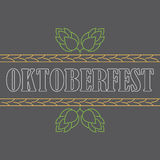 Oktoberfest. Banner or poster autumn festival with cones of hops on the grey background. Royalty Free Stock Photos
