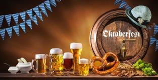 Oktoberfest beer barrel and beer glasses stock images