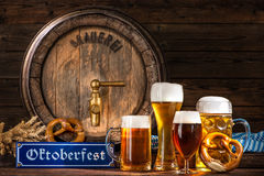 Oktoberfest beer barrel with beer mugs Royalty Free Stock Images