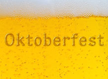 Oktoberfest Beer Festival. Close up of beer with bubbles and foam with Oktoberfest Festival inscription Royalty Free Stock Image