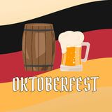 OKTOBERFEST beer festival. Wooden barrel and glasses of beer on background the flag of Germany. Royalty Free Stock Photo