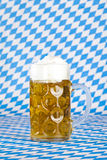 Oktoberfest beer stein and Bavarian flag Stock Photography