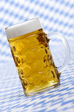Oktoberfest Beer stein called Mass. Close-up of original Bavarian Oktoberfest Beer stein called Mass full of beer with foam crown Royalty Free Stock Photography