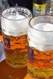 Oktoberfest, Munich Germany. Two Augustiner one litre beer mugs at the Oktoberfest in Munich, Germany Stock Images