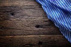 Oktoberfest. The blue checkered tablecloth or napkin typical of the Munich Beer Festival in the German Oktoberfest. Free space for your text product or Royalty Free Stock Images