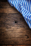 Oktoberfest. The blue checkered tablecloth or napkin typical of the Munich Beer Festival in the German Oktoberfest. Free space for your text product or Stock Image
