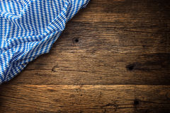 Oktoberfest. The blue checkered tablecloth or napkin typical of the Munich Beer Festival in the German Oktoberfest. Free space for your text product or Stock Photos