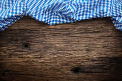 Oktoberfest. The blue checkered tablecloth or napkin typical of the Munich Beer Festival in the German Oktoberfest. Free space for your text product or Stock Photo