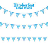 Oktoberfest buntings. Decorations for Oktoberfest. Garland buntings of Bavarian checkered blue flag. Stock Photo
