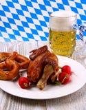 Oktoberfest chicken with radish, pretzel and beer Royalty Free Stock Photo
