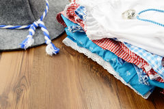 Oktoberfest cloth like filth hart dirndl dress and leather trousers stock photos