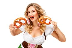 Oktoberfest. Creative concept photo of Oktoberfest waitress wearing a traditional Bavarian costume with pretzels isolated on white background stock images