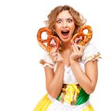 Oktoberfest. Creative concept photo of Oktoberfest waitress wearing a traditional Bavarian costume with pretzels isolated on white background stock image