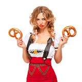 Oktoberfest. Creative concept photo of Oktoberfest waitress wearing a traditional Bavarian costume with pretzels isolated on white background stock photography