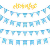 Oktoberfest decorations. Buntings for Oktoberfest. Garland buntings of Bavarian checkered blue flag, and hand lettering. Oktoberfest logo Royalty Free Stock Photography