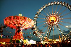 Oktoberfest fairground at night Stock Photo