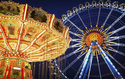 Oktoberfest. Famous ferris wheel and old carousel at the oktoberfest in munich - germany Royalty Free Stock Image