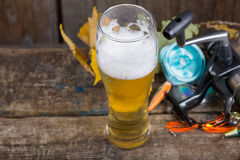 Oktoberfest with fishing tackles and glass a beer Stock Photography