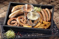 Oktoberfest food, appetizing meat sausages, beer snacks for a la. Rge company. A large assortment of beer snacks on a wooden tray stock image