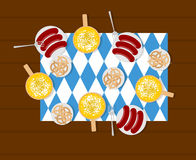 Oktoberfest food. Beer and sausages. Pretzels in plate. Meal for Royalty Free Stock Images