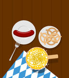 Oktoberfest food. Beer and sausages. Pretzels in plate. Meal for Royalty Free Stock Photography