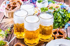 Oktoberfest food menu, bavarian sausages with pretzels, mashed potato, sauerkraut, beer stock photo