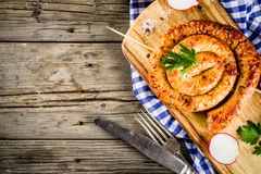 Oktoberfest food concept. Oktoberfest food menu, bavarian sausages on wooden background, copy space above royalty free stock photography